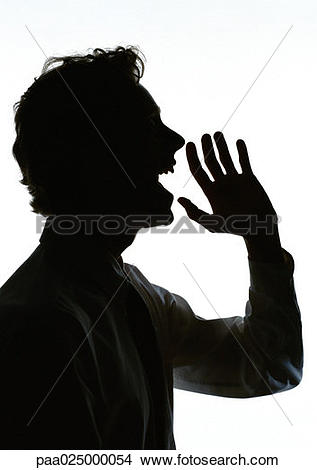 Stock Photo of Man yelling with hand out in front of mouth.