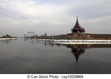 Stock Image of reflection of palace wall in Mandalay, Myanmar.
