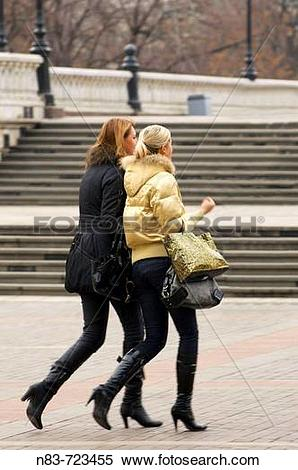 Stock Image of Two young fashionable Moscovite women walk.