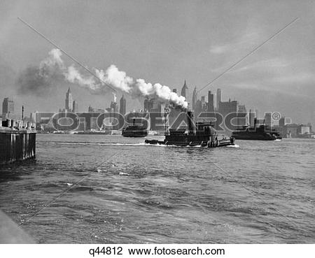 Stock Photo of 1933 1930S Retro Tug Boat Steam River Skyline.
