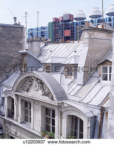 Picture of Mansard roof and windows on traditional house in Paris.