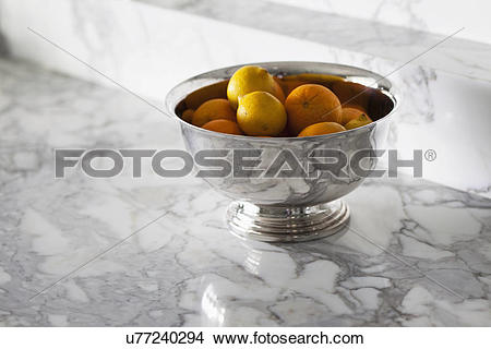 Stock Photo of Bowl of oranges on marble countertop; Corona Del.