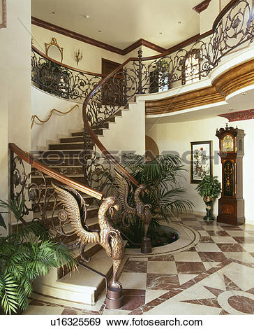 Stock Photograph of Ornate metal bannisters on stairs in hall with.