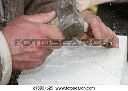 Stock Photograph of old craftsman Mason during the processing of a.