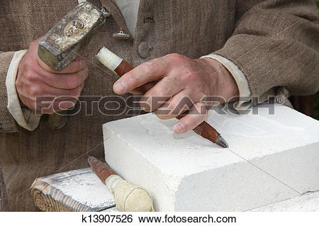 Stock Images of old craftsman Mason during the processing of a.