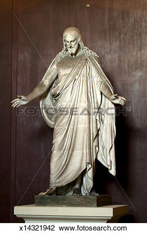 Stock Photo of Marble sculpture of Jesus standing against wall.