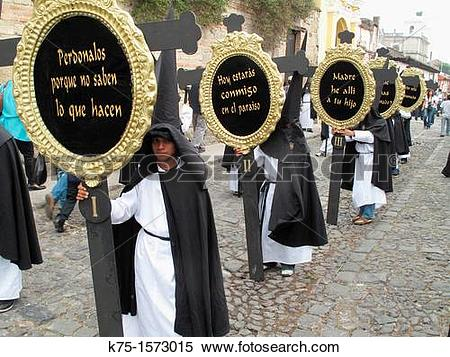 Stock Image of Marchers in Holy Week procession with signs k75.