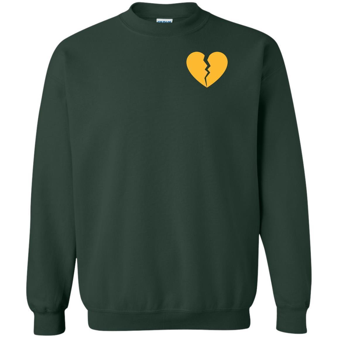 Marcus Lemonis Heart Logo On Sweater.