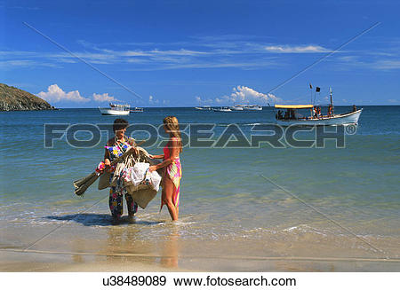 Stock Photograph of Woman selling souviners on Margarita Island.