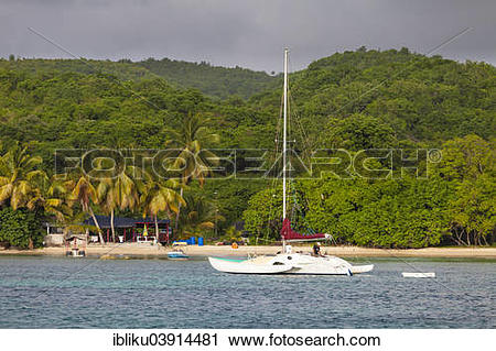 Stock Photography of Beach with sailing boat, Marie Galante.