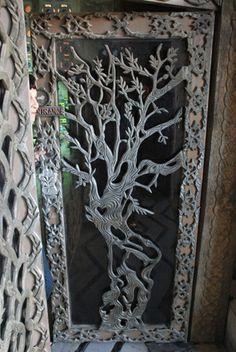 "door ""La raccolta delle olive"" di Mario Borella, Valloria, Italy."
