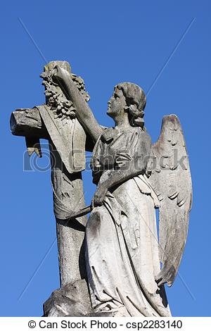 Stock Photography of Angel and cross gravestone marker.