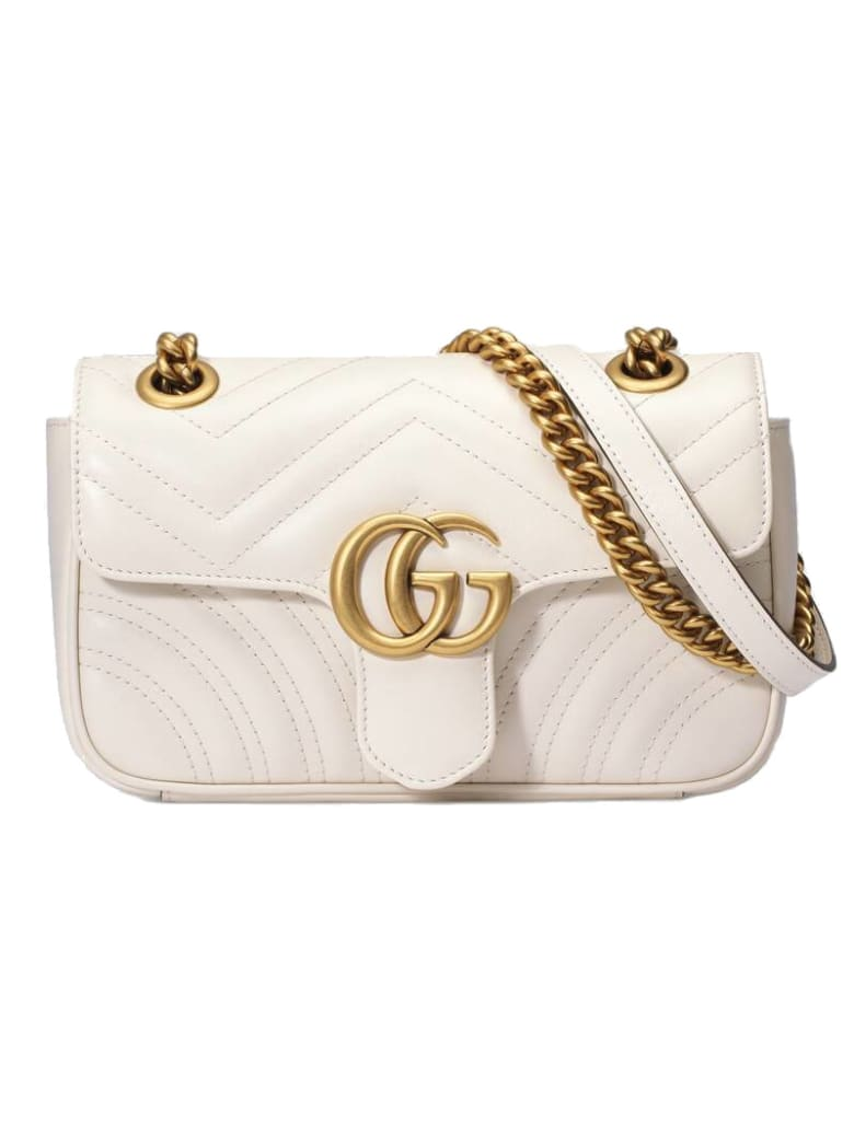 Gucci Gg Marmont Xs I: Whit Flap , Brass Logo Gg On The Flap Chain And  Strap Brass.