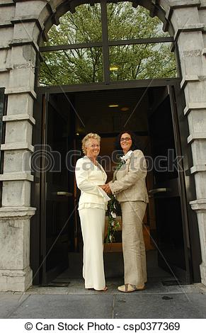 Stock Photographs of Lesbian brides in front of town hall after.