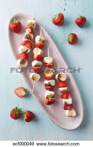 Stock Photograph of Marshmallow and strawberry skewers in tray.