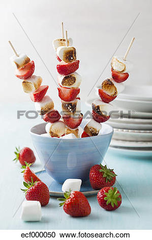Stock Photography of Marshmallow and strawberry skewers in bowl.
