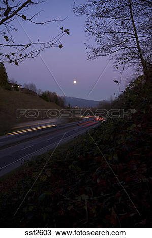 Stock Photo of Mary Hill Bypass traffic around a curve under a.
