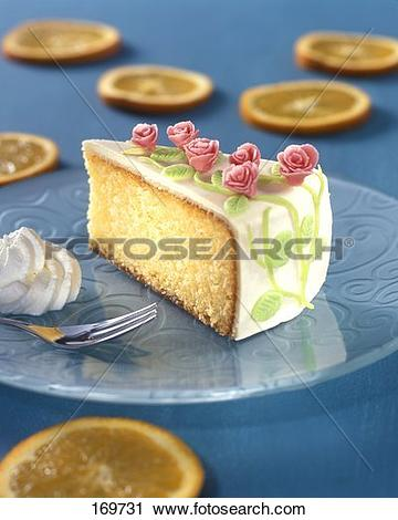 Stock Photography of A piece of sponge cake with icing & marzipan.