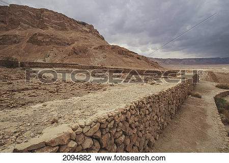 Stock Photo of A stone wall in a roman camp; masada southern.