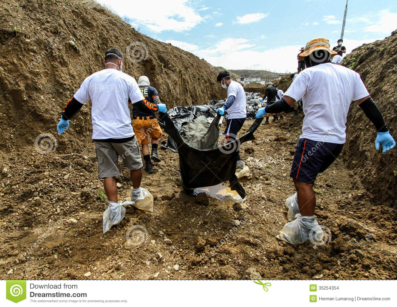 Mass Grave For Victims Of Typhoon Haiyan In Philippines Editorial.