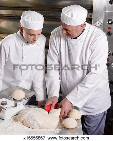 Picture of Master baker kneading dough, teaching teenage (16.
