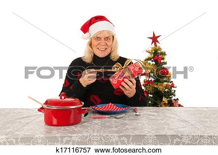 Picture of Woman of mature age alone with Christmas k17116757.