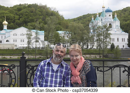 Stock Photos of Church Svyatogorsk Lavra. Portrait couples mature.