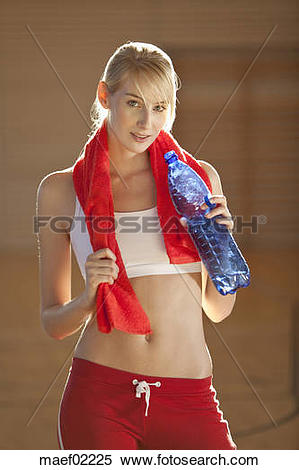 Stock Image of Germany, Mauern, Woman holding water bottle.