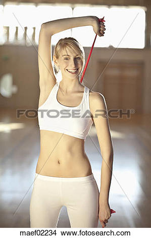 Stock Photo of Germany, Mauern, Woman stretching rubber band.