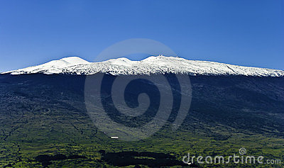 Mauna Kea And Snow Capped Peaks Stock Photo.