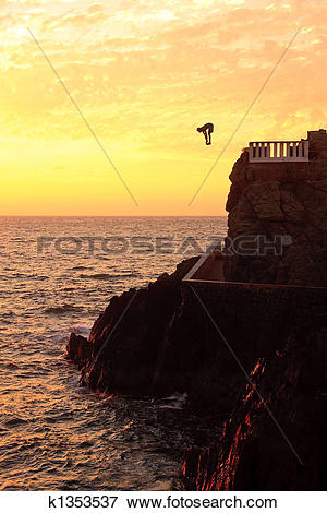 Picture of Cliff diver off the coast of Mazatlan at sunset.