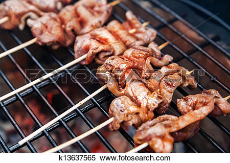 Stock Image of Meat rolls with bacon on grill k13637565.