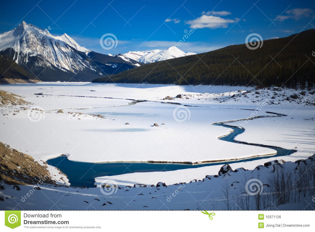 Ice Breaking At Medicine Lake At Rock Mountain Royalty Free Stock.