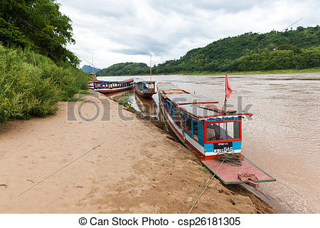 Stock Photography of Traditional laotian boats on the bank of.