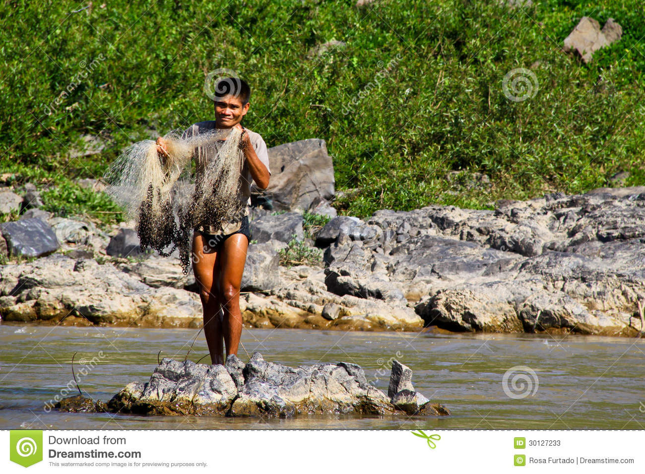 A Fisherman On The Mekong River, Laos Editorial Stock Photo.