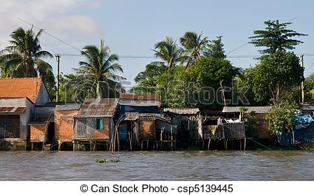 Stock Images of Mekong river huts.
