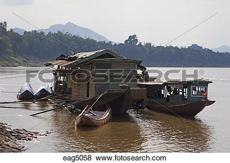 Pictures of Houseboat and pole boat on the Mekong River in the.