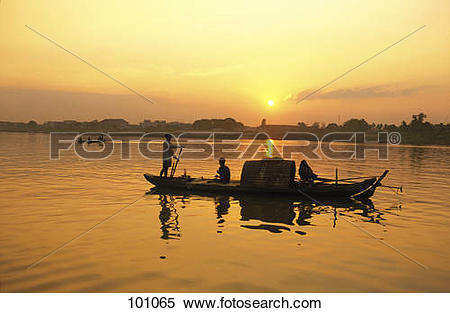 Stock Image of Silhouette of fishermen on boat in river, Mekong.