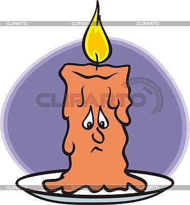 Melting wax of burning candle.