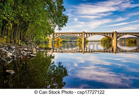 Stock Photo of The Veterans Memorial Bridge reflecting in the.