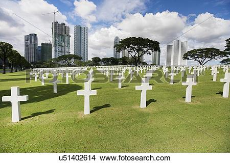 Stock Photo of The American Memorial Cemetery with buildings in.