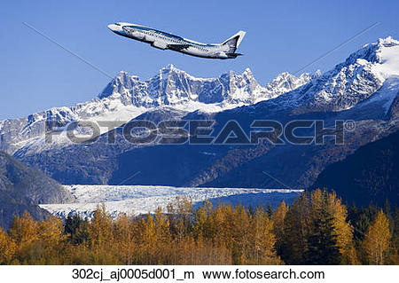 Stock Photo of AK Airlines *Salmon* Jet over Mendenhall Glacier.