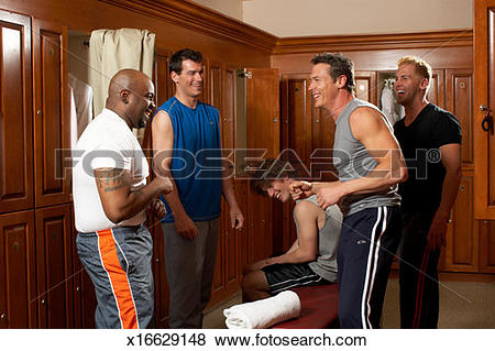 Pictures of Group of men in locker room, laughing x16629148.