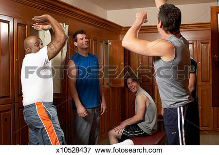 Picture of Group of men celebrating in locker room, arms raised.