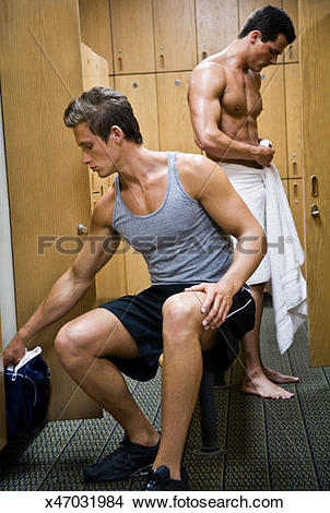 Stock Photo of Two men changing clothes in locker room x47031984.