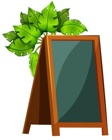 An empty menu board with plants.