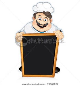 Image: A Smiling Chef Behind a Blackboard Menu.