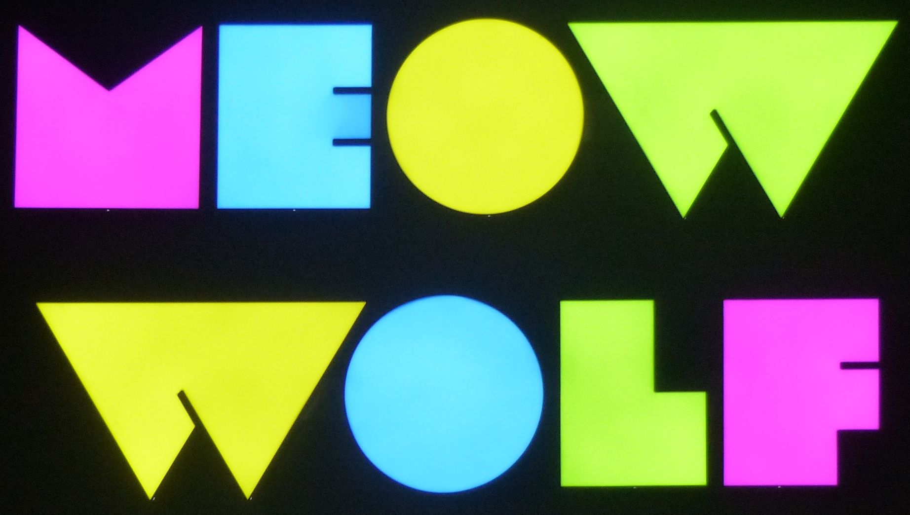 meow wolf logo.