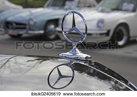"Stock Photograph of ""Mercedes star, with a reflection."