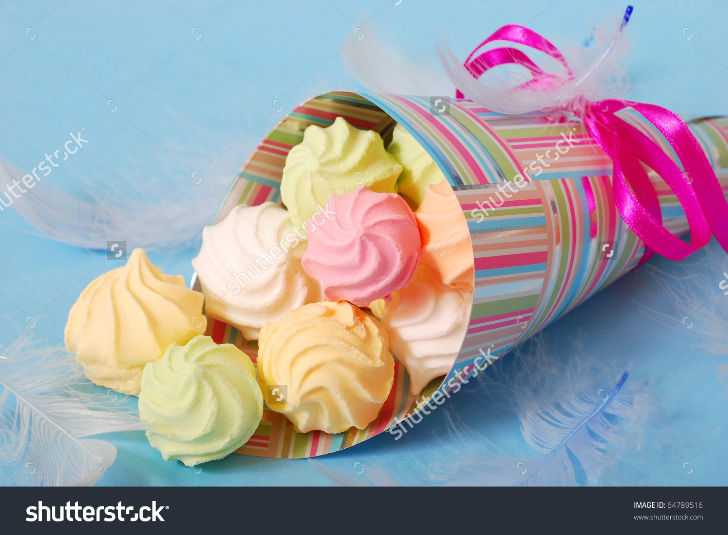 Colorful Meringues In Paper Cone For Birthday Party Stock Photo.